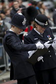 Superintendent, Operations, Pippa Mills discussing arrangements. Policing as the military funeral procession of former British Prime Minister Margaret Thatcher passes Ludgate Circus to St Pauls Cather... - Jess Hurd - 17-04-2013