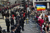 Protesters gather and turn their backs on as the military funeral procession of former British Prime Minister Margaret Thatcher passes Ludgate Circus to St Paul's Catherdral. City of London - Jess Hurd - 17-04-2013