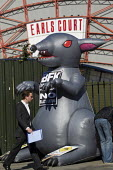 Giant rat, Protest by blacklisted workers outside the Railtex Exhibition, where the Crossrail CEO is making a keynote address. Earls Court, London. - Jess Hurd - ,2010s,2013,activist,activists,at,blacklist,blacklisted,blacklisting,campaign,campaigner,campaigners,campaigning,CAMPAIGNS,Court,DEMONSTRATING,Demonstration,DEMONSTRATIONS,dismissal,Exhibition,group,g