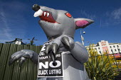 Giant rat, Protest by blacklisted workers outside the Railtex Exhibition, where the Crossrail CEO is making a keynote address. Earls Court, London. - Jess Hurd - 2010s,2013,activist,activists,at,blacklist,blacklisted,blacklisting,campaign,campaigner,campaigners,campaigning,CAMPAIGNS,Court,DEMONSTRATING,Demonstration,DEMONSTRATIONS,dismissal,Exhibition,group,gr