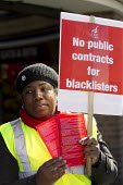 Protest by blacklisted workers outside the Railtex Exhibition, where the Crossrail CEO is making a key note address. Earls Court, London. - Jess Hurd - ,2010s,2013,activist,activists,at,BAME,BAMEs,Black,blacklist,blacklisted,blacklisting,BME,bmes,campaign,campaigner,campaigners,campaigning,CAMPAIGNS,Court,DEMONSTRATING,Demonstration,DEMONSTRATIONS,di