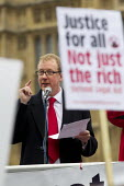 Dave Rowntree (Solicitor and drummer in Blur). Protest outside Parliament to defend legal aid. Westminster, London. - Jess Hurd - 22-05-2013
