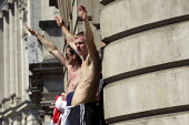EDL supporter gives a fascist salute. English Defence League demonstrate in Whitehall after the murder of soldier Lee Rigby. Westminster, London. - Jess Hurd - 2010s,2013,activist,activists,bigotry,CAMPAIGN,campaigner,campaigners,CAMPAIGNING,CAMPAIGNS,Defence,DEFENSE,DEMONSTRATING,Demonstration,DEMONSTRATIONS,DISCRIMINATION,EDL,English Defence League,equal,e