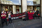 Protesters demonstrate against the corporate murder of garment workers in Bangladesh. The sub standard factories supply Matalan, Mango and Primark high street chains. Oxford St. May day, International... - Jess Hurd - 01-05-2013