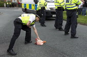 EDL members throw pigs heads at police lines. English Defence League march against a proposed Muslim community Centre which would redevelop a disused pub in Moortown, Leeds. - Jess Hurd - 04-05-2013