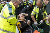 Injured protester Amy Jowett UCU member, is taken to hospital with a broken leg as anti fascists block the road outside Parliament to prevent the British National Party from marching to the Cenataph a... - Jess Hurd - 01-06-2013
