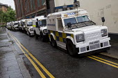 Armoured Land Rover Police vehicles. Security and policing, graffiti: Fight Together For Something. G8 Not Welcome, trade union protest in Belfast against the G8 summit, Northern Ireland. - Jess Hurd - &,2010s,2013,activist,activists,adult,adults,against,austerity,CAMPAIGN,campaigner,campaigners,CAMPAIGNING,CAMPAIGNS,CLJ,Crime,DEMONSTRATING,Demonstration,DEMONSTRATIONS,Irish,Justice,Land,Law,MATURE,
