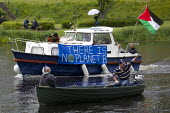 Protest against the G8 Summit, Fermanagh. Northern Ireland. - Jess Hurd - Irish,2010s,2013,activist,activists,against,anti,banner,banners,boat,boats,CAMPAIGN,campaigner,campaigners,CAMPAIGNING,CAMPAIGNS,DEMONSTRATING,Demonstration,DEMONSTRATIONS,Protest,PROTESTER,PROTESTERS