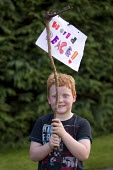 Boy with a World Peace banner. Protest against the G8 Summit, Fermanagh. Northern Ireland. - Jess Hurd - 17-06-2013