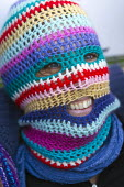 Knitted balaclava as a jokey protest against the huge security operation. Protest against the G8 Summit, County Fermanagh. Northern Ireland. - Jess Hurd - 17-06-2013