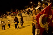 Turkish flag with Mustafa Kemal Ataturk. Protests in Taksim Square began when police attacked a camp occupation against the redevelopment of Gezi Park but protests have escalated across the country ag... - Jess Hurd - 06-06-2013