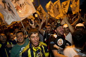 Football supporters march into Taksim Square. Protests began when police attacked a camp occupation against the redevelopment of Gezi Park but protests have escalated across the country against Prime... - Jess Hurd - 08-06-2013