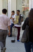 Playing an accordion. Begging for money in Istanbul, Turkey. - Jess Hurd - 10-06-2013