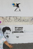 Graffiti supporting Gezi Park protests, which escalated across the country against Prime Minister Tayyip Erdogan, his AKP governments conservative policies and state repression. Istanbul, Turkey. - Jess Hurd - 10-06-2013