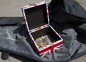 Buskers Union Jack contributions box, Stratford Upon Avon. - Jess Hurd - 2010s,2013,baggar,beg,beggar,beggars,BEGGER,begging,begs,busker,coin,Coinage,coins,DOWNTURN,EBF,Economic,Economy,flag,flags,melody,money,music,MUSICAL,musician,MUSICIANS,patriotic,PEOPLE,player,player