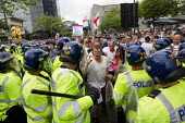 Man with his scared child on an English Defence League protest in Birmingham, West Midlands. - Jess Hurd - 20-07-2013