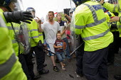 Man with his scared child on an English Defence League protest in Birmingham, West Midlands. - Jess Hurd - 2010s,2013,activist,activists,adult,adults,anger,angry,anti racist,bigotry,Birmingham,boy,boys,CAMPAIGN,campaigner,campaigners,CAMPAIGNING,CAMPAIGNS,child,CHILDHOOD,children,cities,city,CLJ,communicat