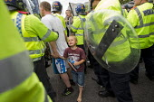 Man with his scared child on an English Defence League protest in Birmingham, West Midlands. - Jess Hurd - ,2010s,2013,activist,activists,adult,adults,anti racist,bigotry,Birmingham,boy,boys,CAMPAIGN,campaigner,campaigners,CAMPAIGNING,CAMPAIGNS,child,CHILDHOOD,children,cities,city,CLJ,Defence,DEFENSE,DEMON