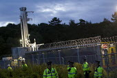 Security fence and police around the rig as anti fracking campaigners join a solidarity day Camp arrives in Balcombe to join a protest against energy company Cuadrilla Resources who are drilling in Ba... - Jess Hurd - 2010s,2013,activist,activists,adult,adults,against,anti,Camp,CAMPAIGN,campaigner,campaigners,CAMPAIGNING,CAMPAIGNS,camps,CLJ,company,degradation,DEMONSTRATING,Demonstration,DEMONSTRATIONS,drill,drilli