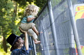Father and daughter on the rig security fence. Anti Fracking campaigners join a civil disobedience day in Balcombe in a protest against energy company Cuadrilla Resources who are drilling in Balcombe,... - Jess Hurd - 2010s,2013,activist,activists,against,anti,CAMPAIGN,campaigner,campaigners,CAMPAIGNING,CAMPAIGNS,child,CHILDHOOD,children,company,DEMONSTRATING,Demonstration,DEMONSTRATIONS,drilling,energy,environment