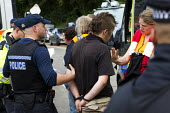 Legal Observer gives arrest advice. Anti Fracking campaigners join a civil disobedience day in Balcombe in a protest against energy company Cuadrilla Resources who are drilling in Balcombe, West Susse... - Jess Hurd - 2010s,2013,activist,activists,adult,adults,against,anti,arrest,arrested,arresting,blockade,blockading,blocking,CAMPAIGN,campaigner,campaigners,CAMPAIGNING,CAMPAIGNS,civil disobedience,CLJ,company,DEMO