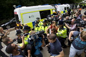 Caroline Lucas, Green MP for Brighton Pavilion, is arrested for taking part in an anti fracking protest. Anti Fracking campaigners join a civil disobedience day in Balcombe in a protest against energy... - Jess Hurd - 2010s,2013,activist,activists,adult,adults,against,anti,arrest,arrested,arresting,blockade,blockading,blocking,CAMPAIGN,campaigner,campaigners,CAMPAIGNING,CAMPAIGNS,civil disobedience,CLJ,company,DEMO