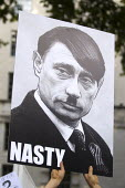 Vladimir Putin as Adolf Hitler poster image, G20 International Day of Action, Global Speak Out on Russia against homophobic law. Downing Street, London. - Jess Hurd - 2010s,2013,ACE,activist,activists,against,anti gay,antigay,art,arts,CAMPAIGN,campaigner,campaigners,CAMPAIGNING,CAMPAIGNS,DEMONSTRATING,Demonstration,DEMONSTRATIONS,equal,equality,Gay,gays,Hitler,homo