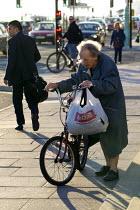 Elderly woman with an Iceland bag. Brighton. - Jess Hurd - 23-09-2013