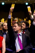 Nick Clegg MP voting in the Economy debate. Liberal Democrats Conference, Glasgow. - Jess Hurd - 2010s,2013,Conference,conferences,democracy,democrat,democrats,economic,Economy,liberal,liberals,party,people,POL,political,POLITICIAN,POLITICIANS,Politics,vote,votes,voting