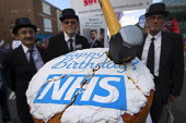 Stockport NHS watch with NHS birthday cake. Save Our NHS demonstration. Conservative Party Conference 2013. Manchester. - Jess Hurd - 29-09-2013
