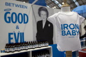 Iron Baby t shirt. Margaret Thatcher memorabilia merchandise The Maggie Collection at The Conservative Party shop. Conservative Party Conference 2013. Manchester. - Jess Hurd - ,2010s,2013,apparel,beer,bottle,bottles,brand,branding,child,CHILDHOOD,children,clothes,clothing,Collection,Conference,conferences,CONSERVATIVE,Conservative Party,conservatives,evil,female,females,gir