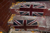 Faded Union Jack doormat on a doorstep in Manchester during Conservative Party Conference. - Jess Hurd - 02-10-2013