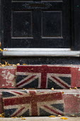 Faded Union Jack doormat on a doorstep in Manchester during Conservative Party Conference. - Jess Hurd - 2010s,2013,British,doorstep,flag,flags,Manchester,nationalism,Party,patriot,Patriotism,pol,political,POLITICIAN,POLITICIANS,politics,SOI Social Issues,Union Jack