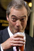 UK Independence Party leader Nigel Farage. UKIP Annual Conference, Westminster Central Hall, London. - Jess Hurd - ,2010s,2013,beer,Conference,conferences,eurosceptic,Euroscepticism,eurosceptics,far right,far right,Independence,leader,LICENSED,London,Party,Pint of Beer,pints,POL,political,POLITICIAN,POLITICIANS,Po