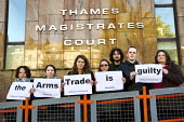 DSEI peace protesters arrested during direct action at the arms fair appear at Thames Magistrates Court, East London - Jess Hurd - 2010s,2013,activist,activists,Anti War,Antiwar,Arms Trade,CAMPAIGN,campaigner,campaigners,CAMPAIGNING,CAMPAIGNS,Court,DEMONSTRATING,Demonstration,DEMONSTRATIONS,fair,London,pacifism,peace,Protest,PROT