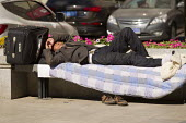 Homeless migrant worker sleeps on the street, Beijing, China. - Jess Hurd - 15-10-2013