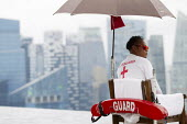 Lifeguard at the Marina Bay Sands SkyPark Infinity Pool, luxury 5 Hotel. Singapore. - Jess Hurd - 22-10-2013