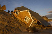Badly damaged cliff-top homes after Xavier, the largest tidal surge in 60 years battered the east coast of England. - Jess Hurd - 06-12-2013