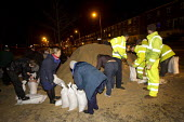 District nurses and council workers filling sandbags before storm surge Xavier hits Great Yarmouth, East Anglia. - Jess Hurd - 05-12-2013