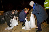 District nurses filling sand bags for vulnerable residents as storm surge Xavier hits Great Yarmouth, East Anglia. - Jess Hurd - 05-12-2013