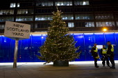 Riot police defend the New Scotland Yard Christmas tree from Cops off Campus student protest. London. - Jess Hurd - 11-12-2013