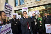 Matt Foot joins a protest outside Westminster Magistrates Court against cuts to legal aid organised by the Criminal Bar Association. Coinciding with criminal barristers and solicitors not attending co... - Jess Hurd - 06-01-2014