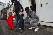 Local resident socialises with the West African refugees. St Pauli Church shelters West African refugees who had formerly worked in Libya, before fleeing and ending up in detention on the Italian isla... - Jess Hurd - 08-01-2014