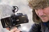 Jason Parkinson, journalist filming. Mount Etna National Park, Sicily, Italy. - Jess Hurd - 13-01-2014