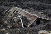 House submerged by lava and ash from an eruption of Mount Etna volcano. Sicily, Italy. - Jess Hurd - 13-01-2014