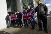 Anti fascist Muslim men hold up the British flag as they demonstrate in Slough against the English Defence League. - Jess Hurd - 01-02-2014