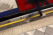 Mind the gap, stepping onto a train, Bank Station, London underground Central Line platform. London. - Jess Hurd - 04-02-2014