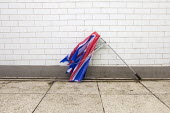 Abandoned, broken, Union Jack umbrella. Westminster, London. - Jess Hurd - 2010s,2014,Abandoned,broken,cities,city,CLIMATE,conditions,damage,damaged,discarded,dispose,flag,flags,holiday,holiday maker,holiday makers,holidaymaker,holidaymakers,holidays,inside,litter,London,nat