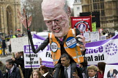 Effigy of Chris Grayling. Save Legal Aid protest marches from Parliament to the Ministry of Justice. Grayling Day. Westminster, London. - Jess Hurd - 07-03-2014