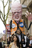 Effigy of Chris Grayling. Save Legal Aid protest marches from Parliament to the Ministry of Justice. Grayling Day. Westminster, London. - Jess Hurd - ACE,ace,culture,Austerity Cuts,barristers,CBA,effigy,figure,figures,Justice Alliance,lawyer,lawyers,Lawyers,legal aid,Protest,Demonstration,solicitor,solicitors,solicitors,strike,strikes,Trade Union,T